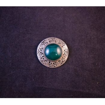 Metal brooch (probably unstamped silver) with green centre stone. Prices includes nationwide delivery