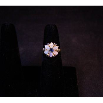 Opal and sapphire cluster daisy ring set in 14k yellow gold. Size J 1/2. Price includes nationwide delivery