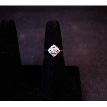 18k white gold and diamond ring featuring a raised centre diamond, surrounded by small diamonds. Total diamond content .5ct. Size K. Price includes nationwide delivery.