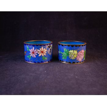 Pair of floral design enamelled brass napkin rings in light blue. Price includes nationwide delivery
