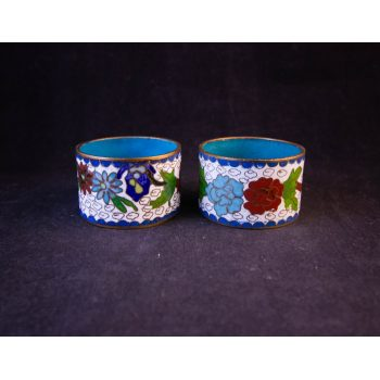 Pair of floral design enamelled brass napkin rings in white. Price includes nationwide delivery