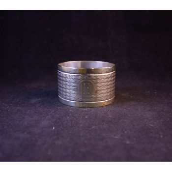 "Silver napkin ring, engraved ""E"". Price includes nationwide delivery"