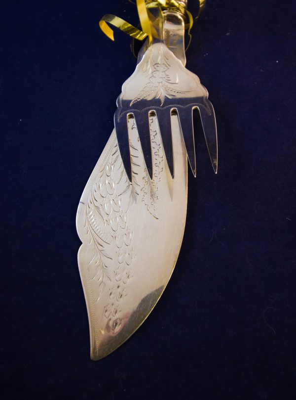 Silver plated fish service knife and fork. No box.