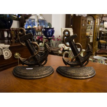 "Pair of anchor shaped cast book ends. Measure 6""H"