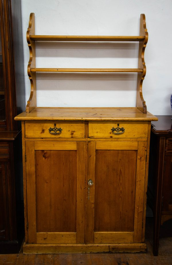 """Antique pine two door, two drawer cabinet with back plate rack. Measures 39""""L x 19""""D x 73""""H"""