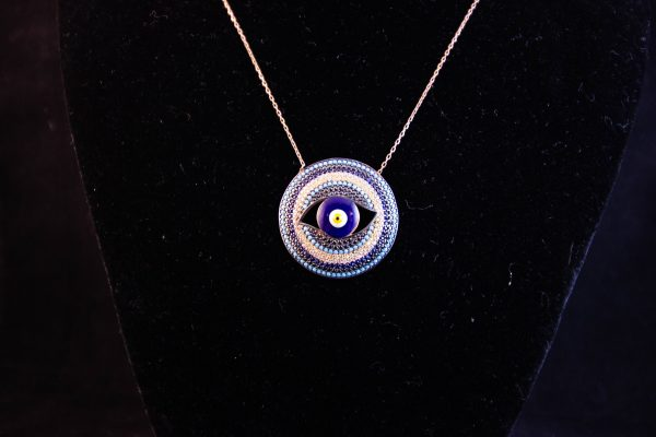 Delicate silver gilt chain with eye shaped enamel pendant