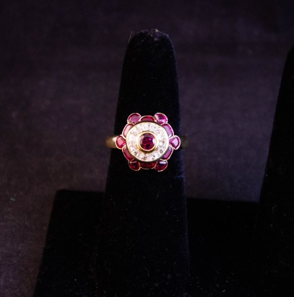 Ruby and diamond bombe cocktail ring set in 18k yellow gold. Size M