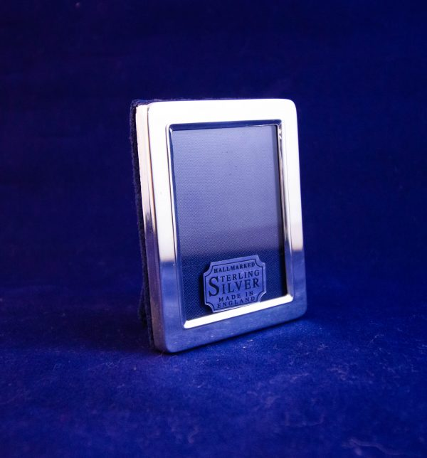 "Small silver photo frame. Photo size 1.5""W x 2""H, total size 2""W x 2.75""H"