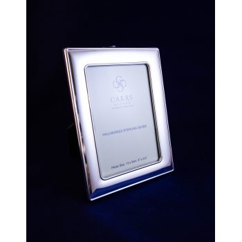 "Silver photo frame with wood back. Photo size 3.5""W x 5""H, total size 5""W x 6.5""H"