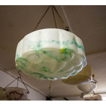 "Mottled green and white glass light shade. Measures 12""W x 6""H"