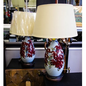 "Pair of painted pottery table lamps. Measures 6""W lamp x 23""H x 14""W shade"
