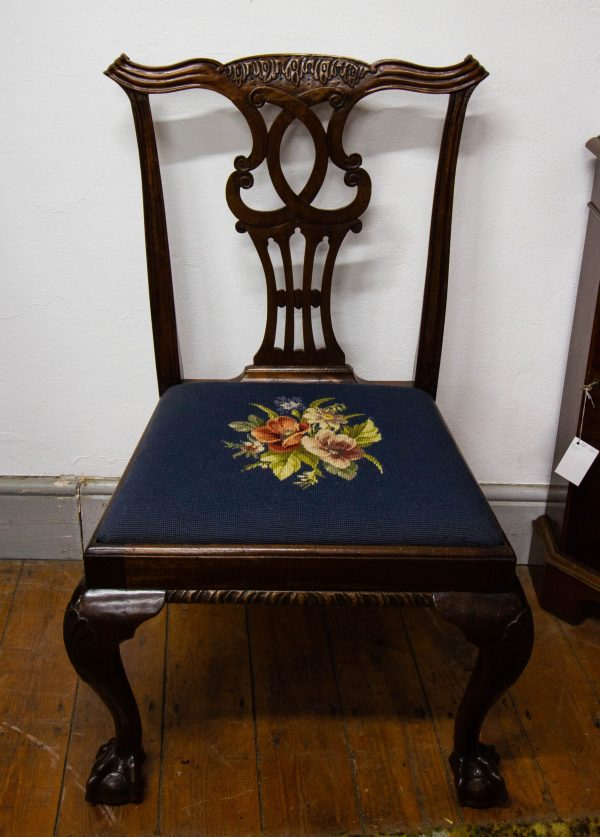 Set of 6 ribbon back mahogany dining chairs with floral tapestry seats.