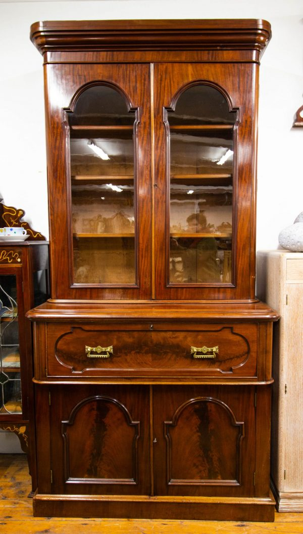 "Antique mahogany secretaire bookcase with leather writing top and brass fittings. Measures 48""L x 23""D x 96""H"