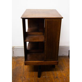 "Neat inlaid mahogany revolving bookcase. Measures 15""L x 15""W x 30""H"