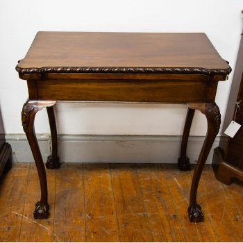 "Fold over mahogany card table. Measures 31""L x 16""D (closed) x 29.5""H"