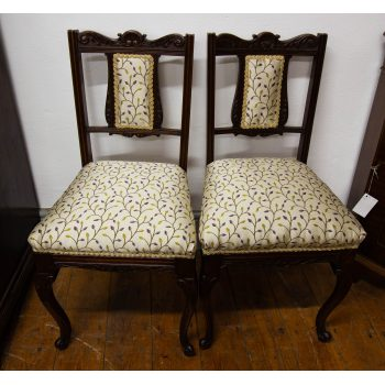 "Pair of stamped carved Edwardian occasional chairs, recently reupholstered. Measures 17""W x 16""D x 33""H"