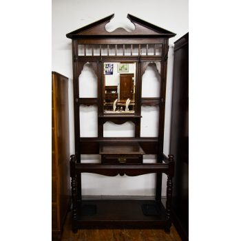 """Edwardian oak hall stand with bevelled mirror and drawer. Measures 45""""L x 14""""D x 89""""H"""