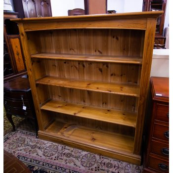"Open pine bookshelf - some marks for wear. Measures 50""L x 12""D x 54""H"