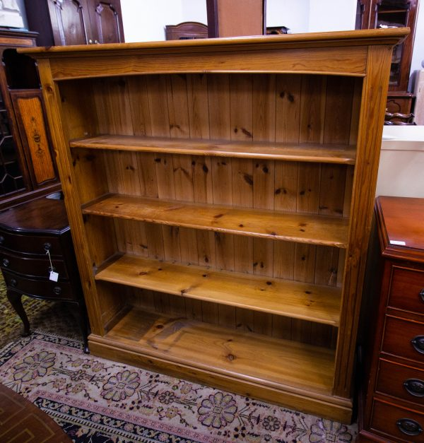 """Open pine bookshelf - some marks for wear. Measures 50""""L x 12""""D x 54""""H"""