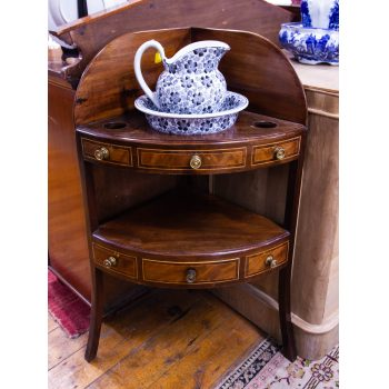 "Georgian inlaid mahogany corner wash stand with drawer. Measures 25""W x 17.5""D x 40""H"
