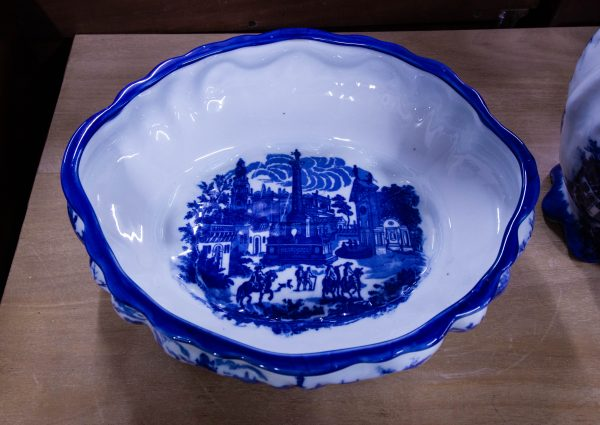 """Ornate blue and white jug and bowl. Bowl measures 16""""L x 14""""W x 4""""H, jug measures 11""""L x 8""""W x 13""""H"""