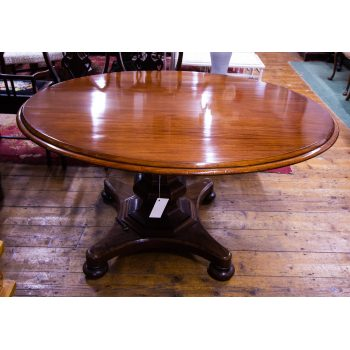 "Mahogany oval centre table on pod leg. Measures 54""L x 45.5""W x 29.5""H"