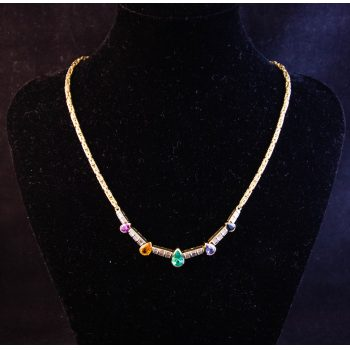 18k yellow gold necklace with 16 channel set baguette diamonds and five pear shaped gemstones. Gemstones are amethyst, citrine, emerald, tanzanite, and sapphire. Price includes nationwide delivery.