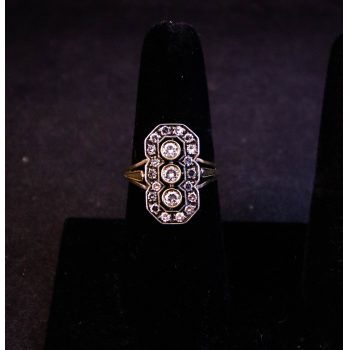 Art deco style vintage yellow gold and diamond ring. 3 main diamonds surrounded by 18 diamonds. Total diamond .45ct. Size O. Price includes nationwide delivery.