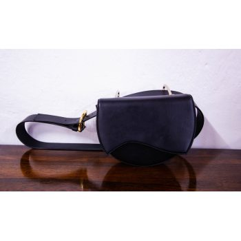 Villatrentuno black leather bumbag with magnet closure. Bag measures 22L x 7D x 16H in cm, belt 127cm. Price includes nationwide delivery