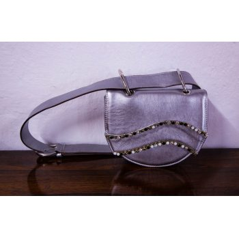 Villatrentuno metallic silver leather bumbag with diamante decorative stones and magnet closure. Bag measures 22L x 7D x 16H in cm, belt 121cm. Price includes nationwide delivery