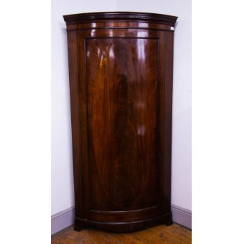 Quality bow front inlaid mahogany corner wardrobe. This has 4 hooks and a clothes rail inside. Measures 98W x 57D x 192.5H in cm. Price includes nationwide delivery.