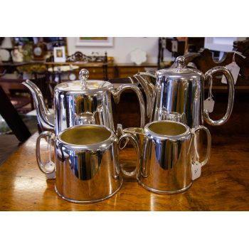 Four piece hotelware silver plated tea and coffee set. Sheffield silver plate, 2 pint tea pot, 1.5 pint coffee/hot water pot. Set includes milk jug and sugar bowl. Price includes nationwide delivery.