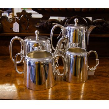 Four piece hotelware silver plated tea and coffee set. Sheffield silver plate, 6 cup tea pot, 6 cup coffee/hot water pot. Set includes milk jug and sugar bowl. Price includes nationwide delivery.